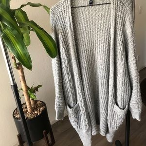Lightly used cable knit grey sweater. Large